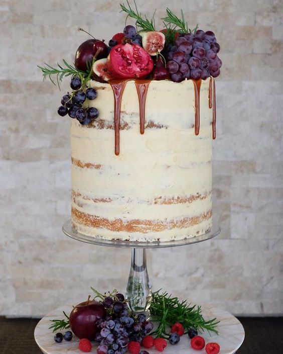 semi naked cake with grapes, pomegranates, figs and chocolate drip
