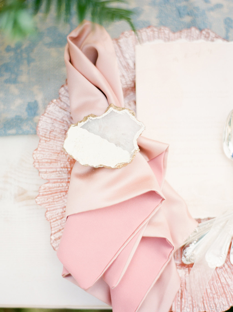 agate napkin holders - photo by Christy Wilson Photography http://ruffledblog.com/summer-castle-soiree-wedding-inspiration