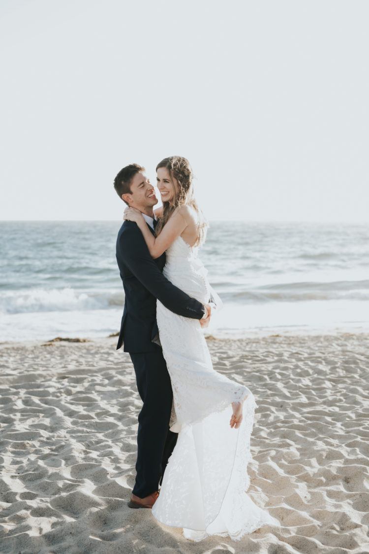 This relaxed beach wedding took place on a Malibu beach and the color palette was all white
