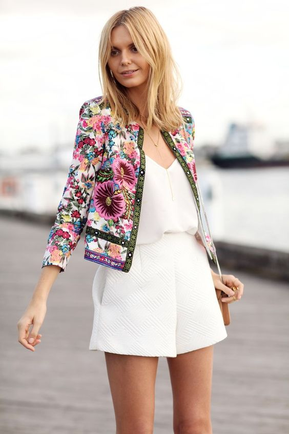 a white romper and a floral embroidery crop jacket