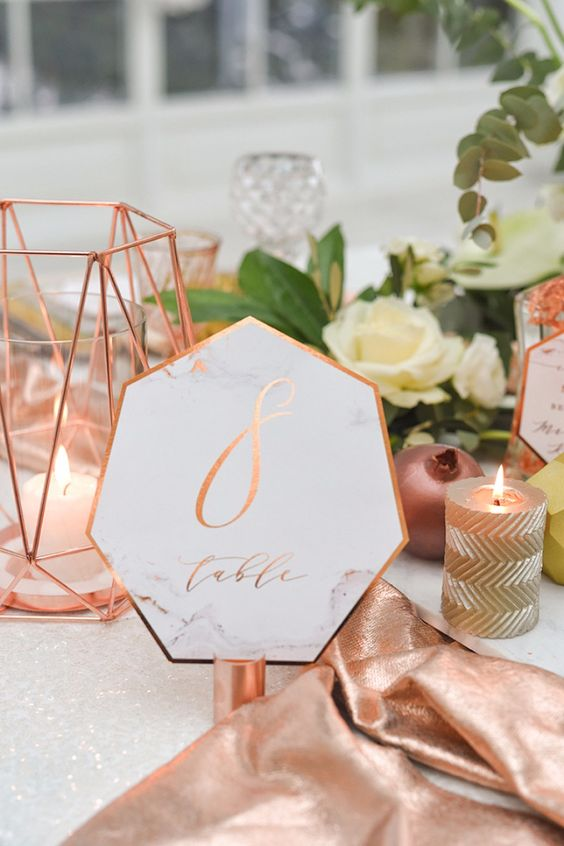 geometric marble wedding table numbers with copper detailing