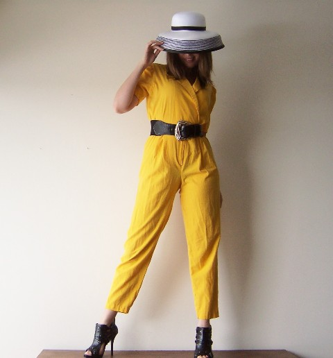 With hat, black belt and cutout shoes