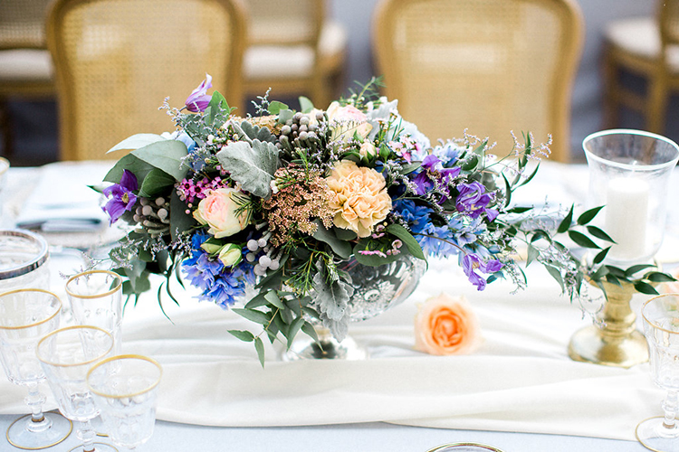 purple centerpieces - photo by Booth Photographics http://ruffledblog.com/watercolor-destination-wedding-in-florence