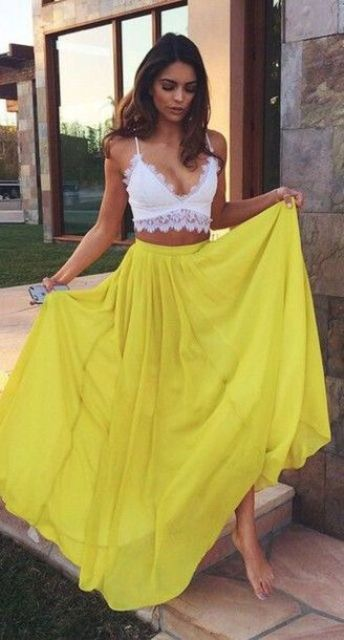 a yellow maxi skirt and a white lace bralette for an effortlessly sexy look