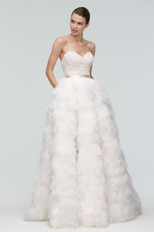strapless sweetheart wedding dress with a textural bodice and a feather skirt