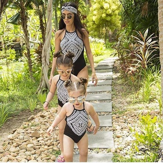 black one piece swimsuits with a tribal print for all the girls
