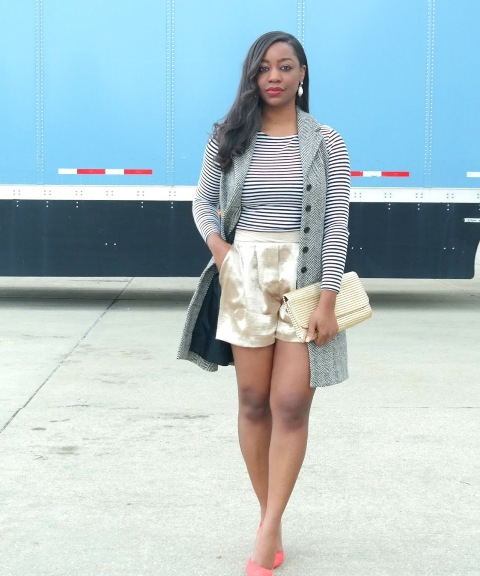 With striped shirt, gray vest, clutch and pink pumps