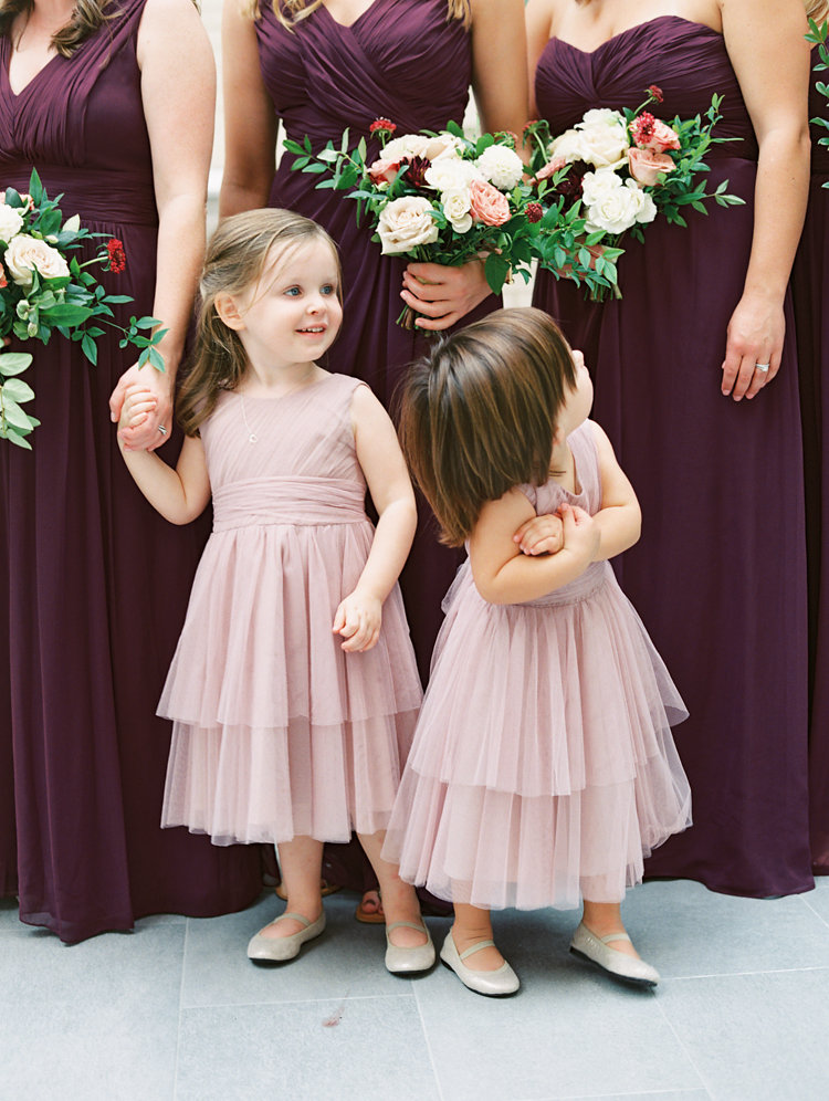 pink flower girl dresses - photo by Bethany Erin Photography http://ruffledblog.com/modern-meets-rustic-wedding-in-dallas