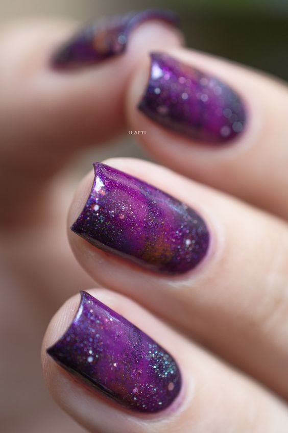 purple galaxy nails with glitter touches