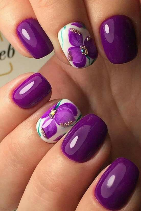 purple manicture with accent floral nails with beads and rhinestones