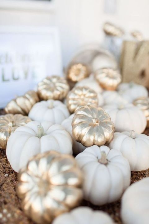 gilded faux pumpkins mixed with white ones for wedding decor