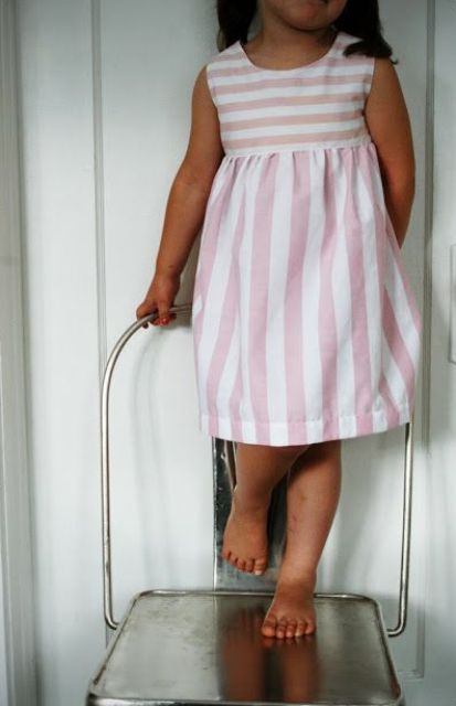pink vertical and horizontal striped dress without sleeves