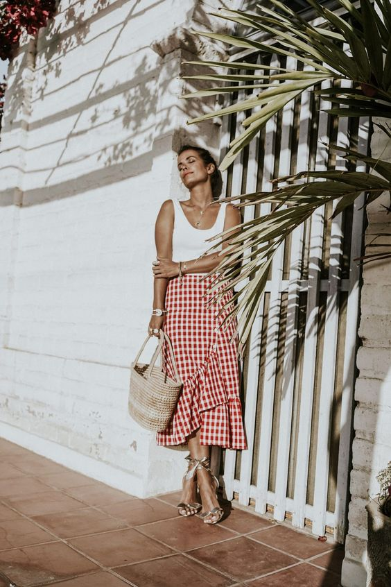 a red and white plaid ruffle skirt, a white top and ankle strap shoes