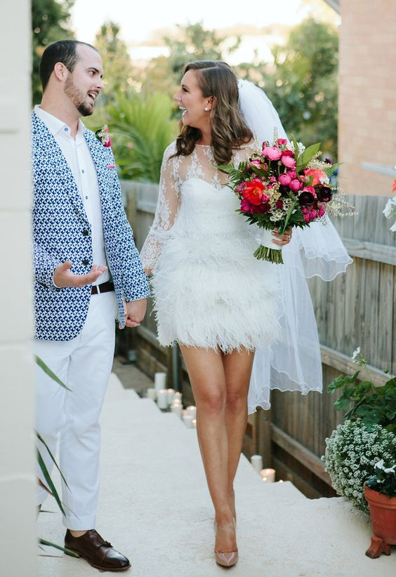 short wedding dress with long sleeves, an illusion neckline and a feather skirt