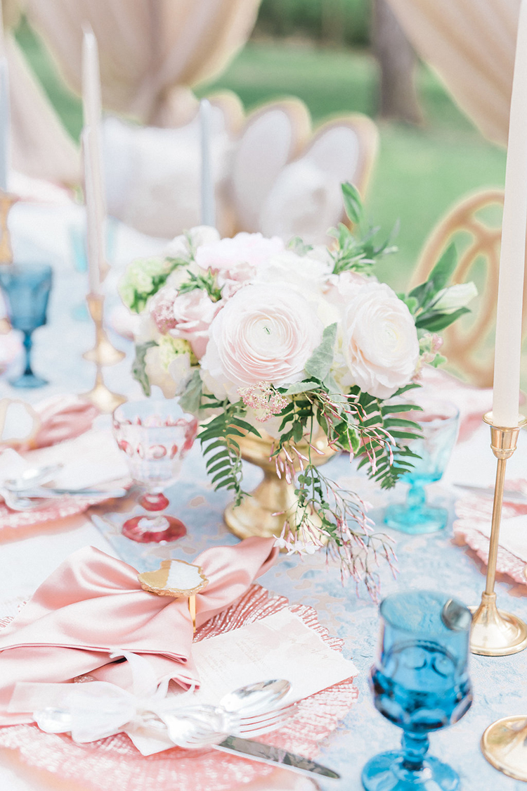 pink centerpieces - photo by Christy Wilson Photography http://ruffledblog.com/summer-castle-soiree-wedding-inspiration