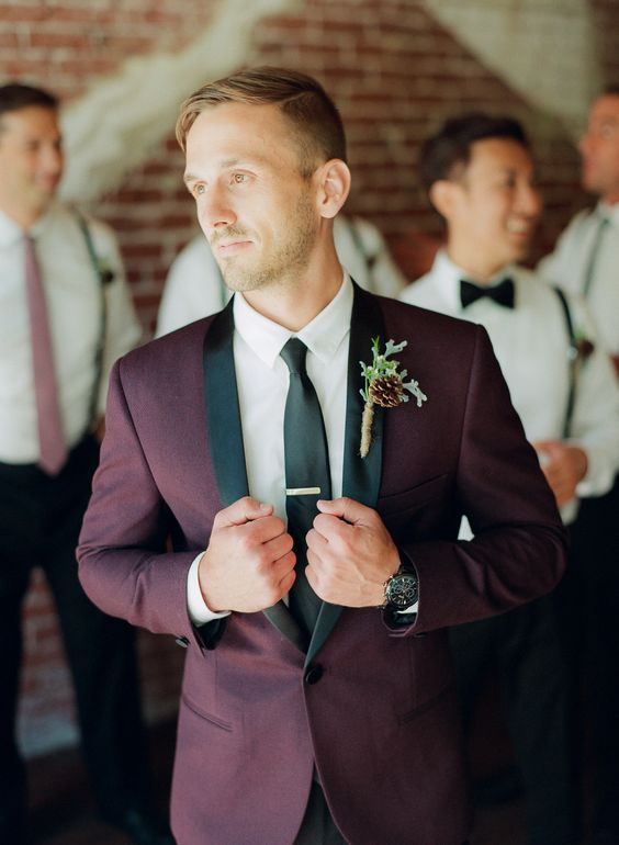 a burgundy and black wedding suit with a white shirt and a black tie