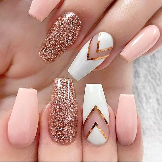 pink nails with a white chevron and rose glitter accent ones