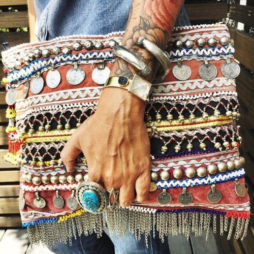 gypsy-inspired clutch with beads, rhinestones, coins, chains and other detailing