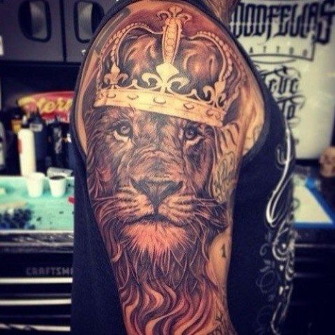 Half-sleeve lion with crown tattoo