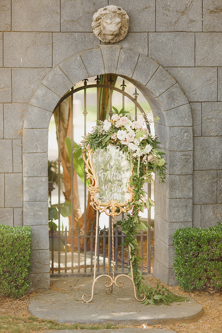 mirrored wedding signage - photo by Kristen Booth Photographer http://ruffledblog.com/majestic-castle-wedding-inspiration-with-celestial-accents