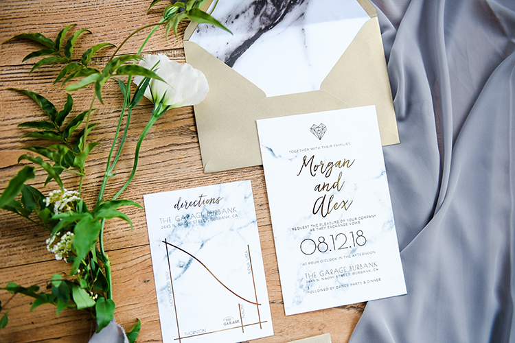 marble wedding invitations - photo by Kate Noelle Photography http://ruffledblog.com/chic-wedding-ideas-inspired-by-partly-cloudy-skies