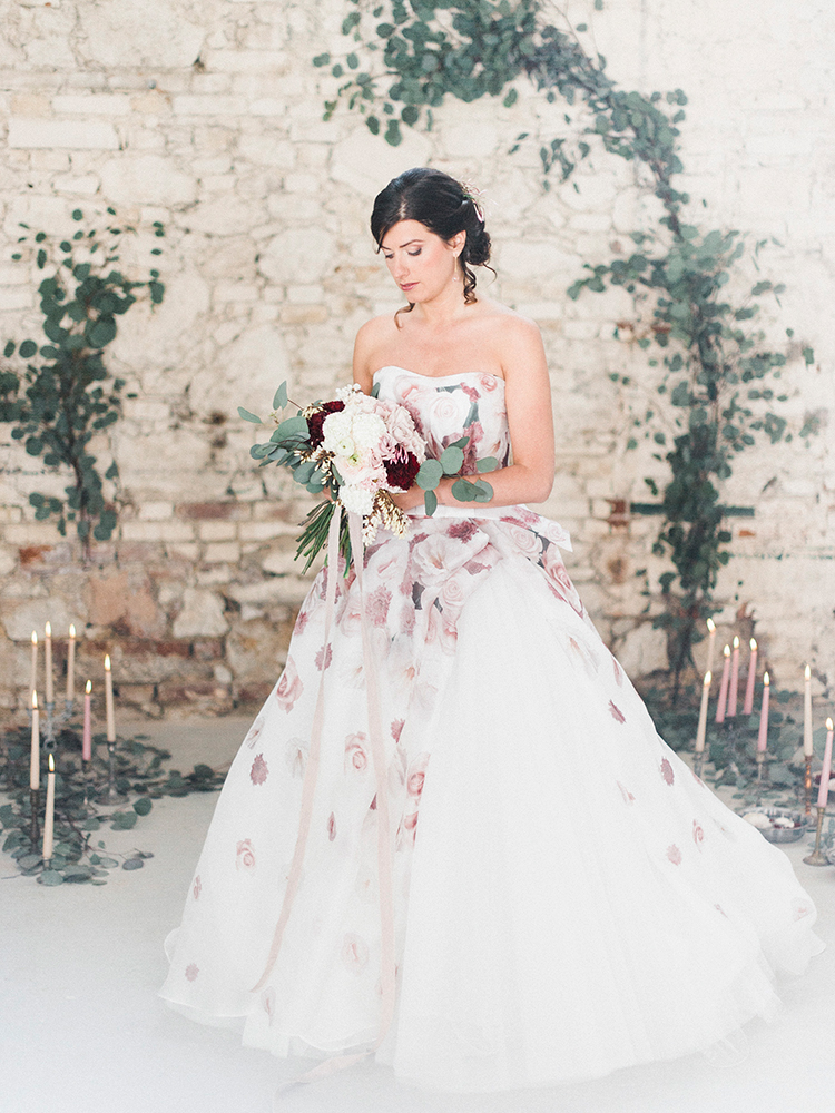 romantic floral wedding dresses - photo by Linda Nari Photography http://ruffledblog.com/tuscan-warehouse-wedding-inspiration-with-a-floral-bridal-gown