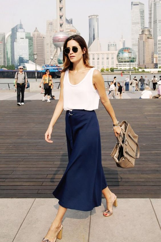 a navy midi skirt, a white strap top and comfy heels