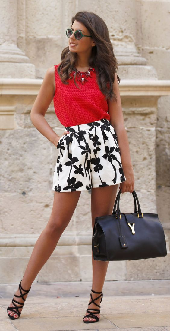 black and white floral print high waist shorts, a red sleeveless top and a black bag