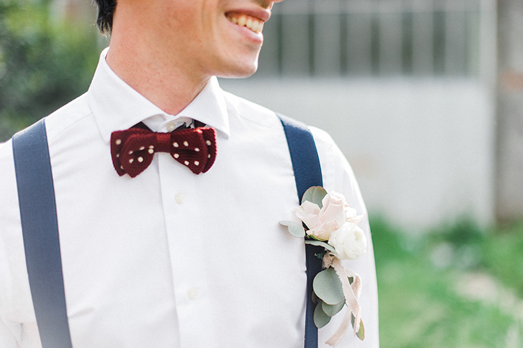 groom looks with suspenders - photo by Linda Nari Photography http://ruffledblog.com/tuscan-warehouse-wedding-inspiration-with-a-floral-bridal-gown