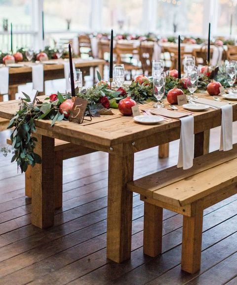 eucalyptus, pomegranates and black candles for chic rustic table decor