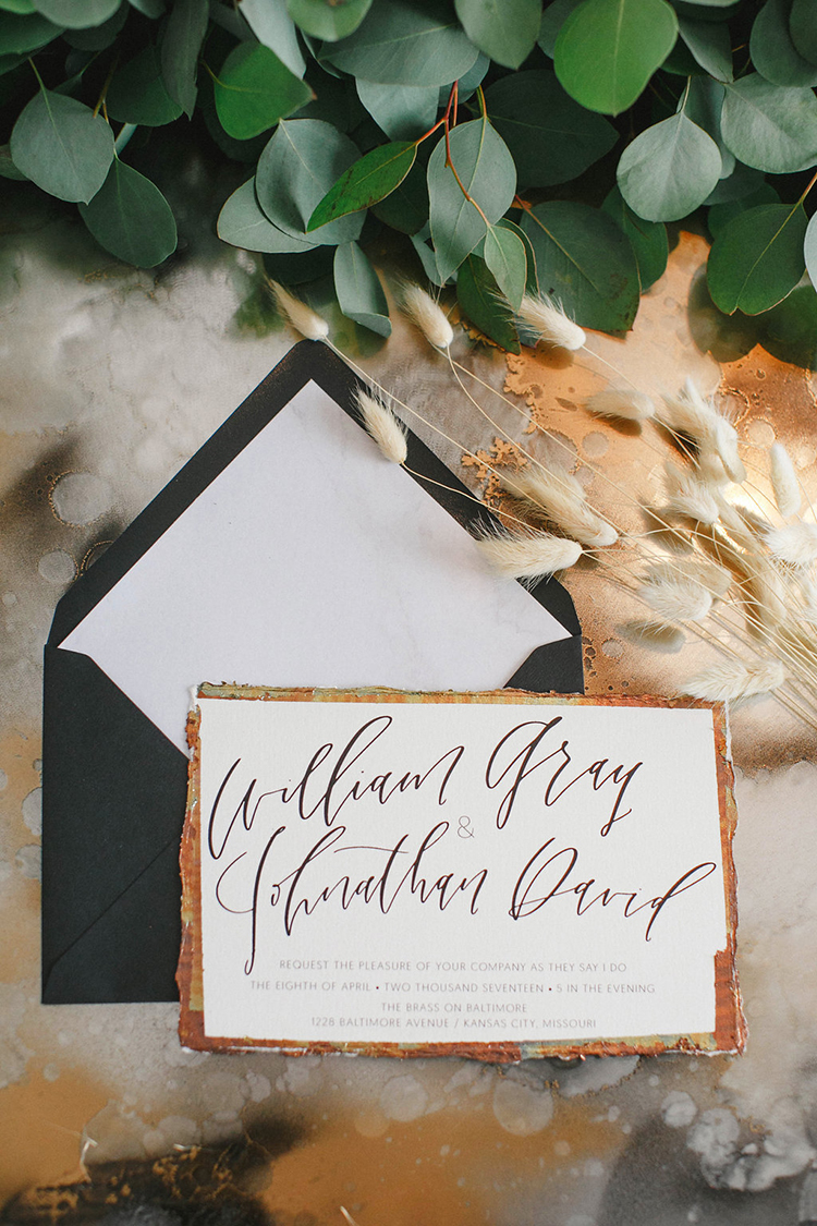 modern wedding invitations with gold and black - photo by Leigh Miller Photography http://ruffledblog.com/modern-wedding-inspiration-with-a-pampas-grass-chandelier