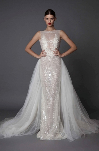 a spakling sleeveless sheath wedding dress with lace appliques and an additional tulle overskirt
