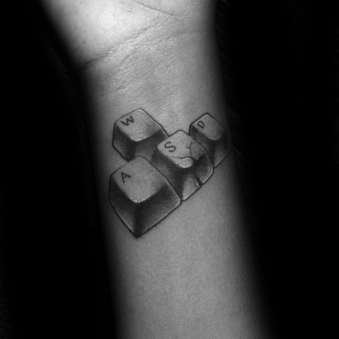 Computer keys tattoo on the wrist