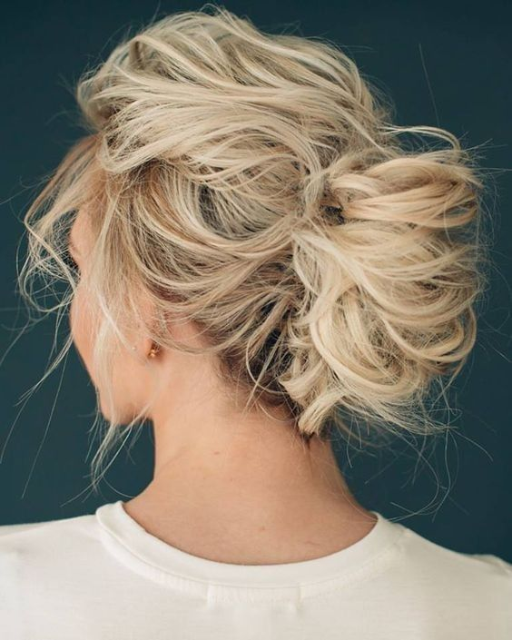 a very messy and loose updo will let the air in and you won't feel too hot