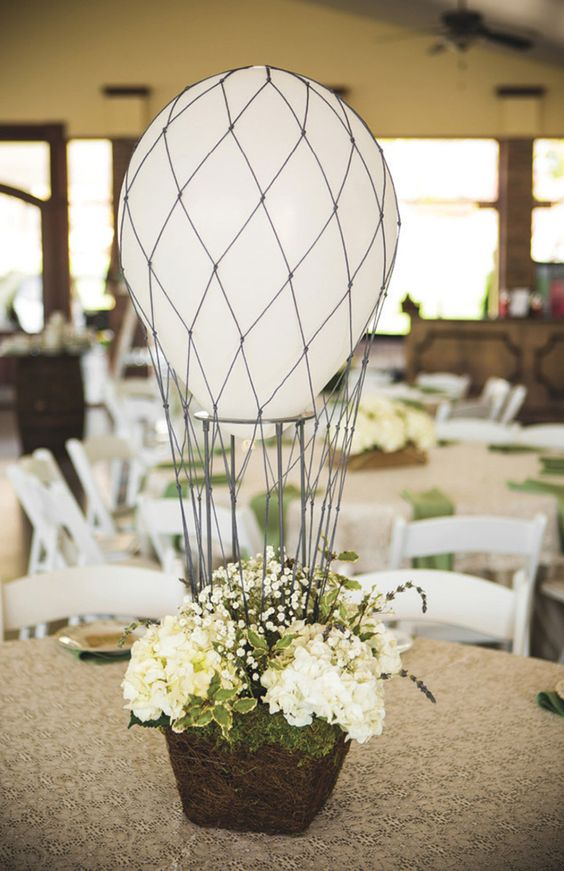 hot air balloon centerpiece with neutral florals and a white balloon