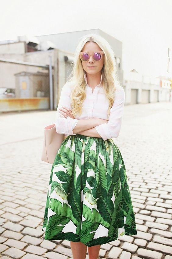 a white shirt, a tropical leaf print midi skirt and a blush tote and sunglasses