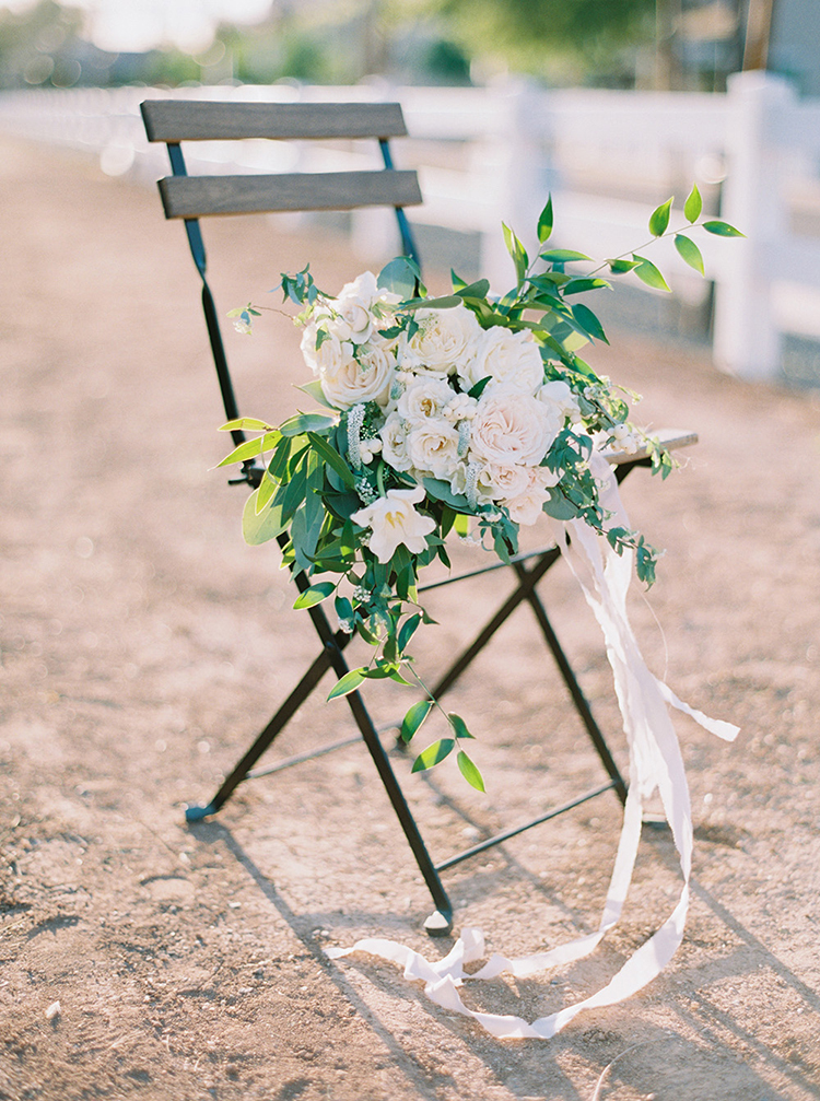 white garden rose bouquets - photo by Melissa Jill Photography http://ruffledblog.com/citrus-and-copper-orchard-wedding-inspiration