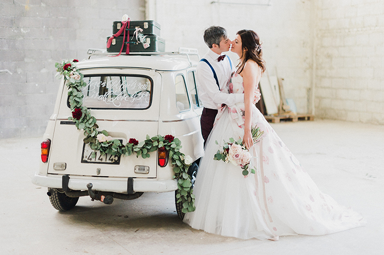 vintage cars at weddings - photo by Linda Nari Photography http://ruffledblog.com/tuscan-warehouse-wedding-inspiration-with-a-floral-bridal-gown