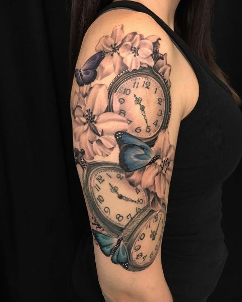 Clock tattoo with pink flowers and blue butterflies