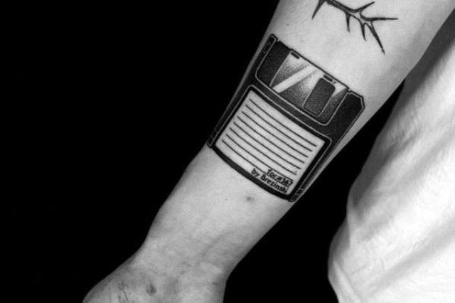Diskette tattoo on the arm