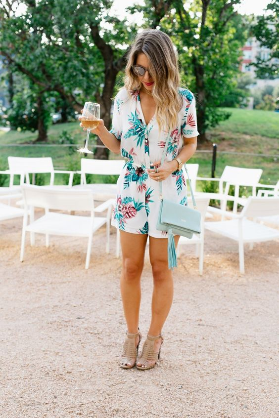 a tropical leaf print white romper, neutral shoes and a mint crossbody bag