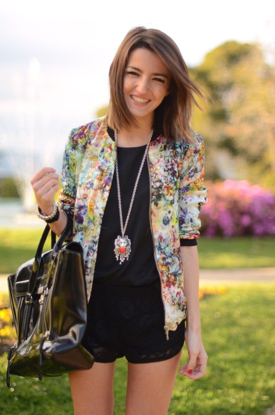 black lace mini shorts, a black top and a bold floral blazer and a large tote