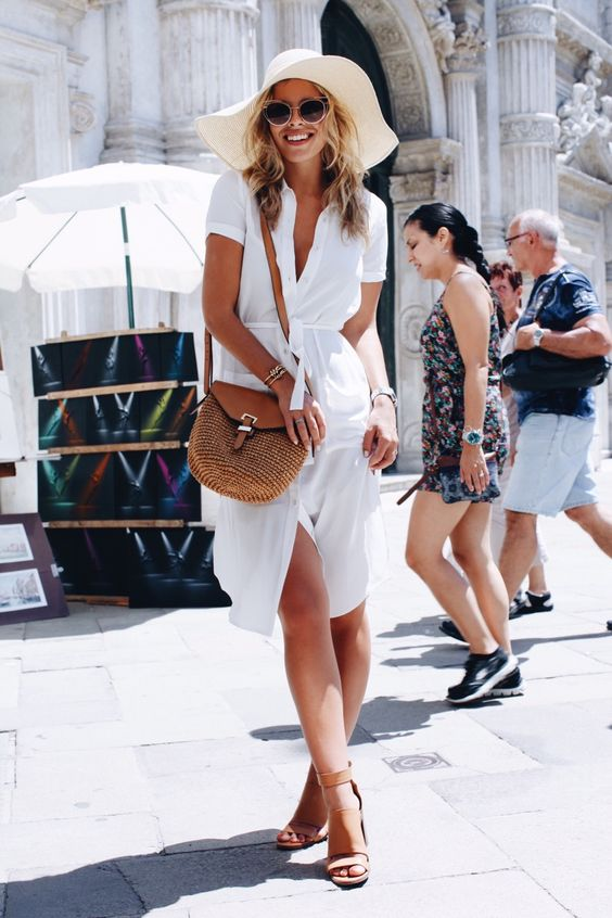 a white shirt dress, brown heels and a brown crossbody bag