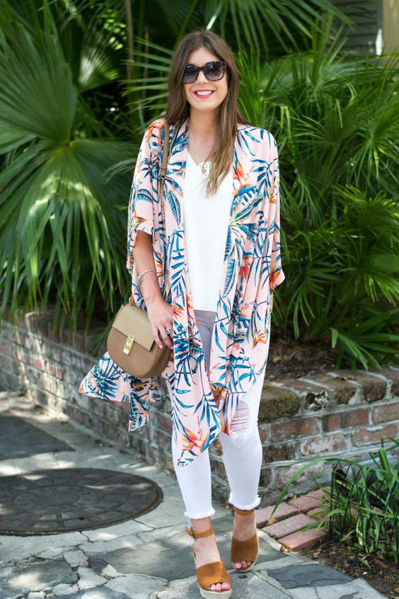 white distressed jeans, a white top, mustard suede shoes and a pink tropical print kimono over