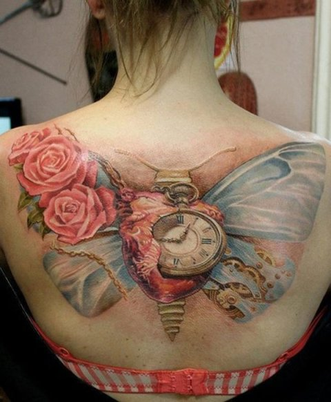 Clock and butterfly wings tattoo on the back