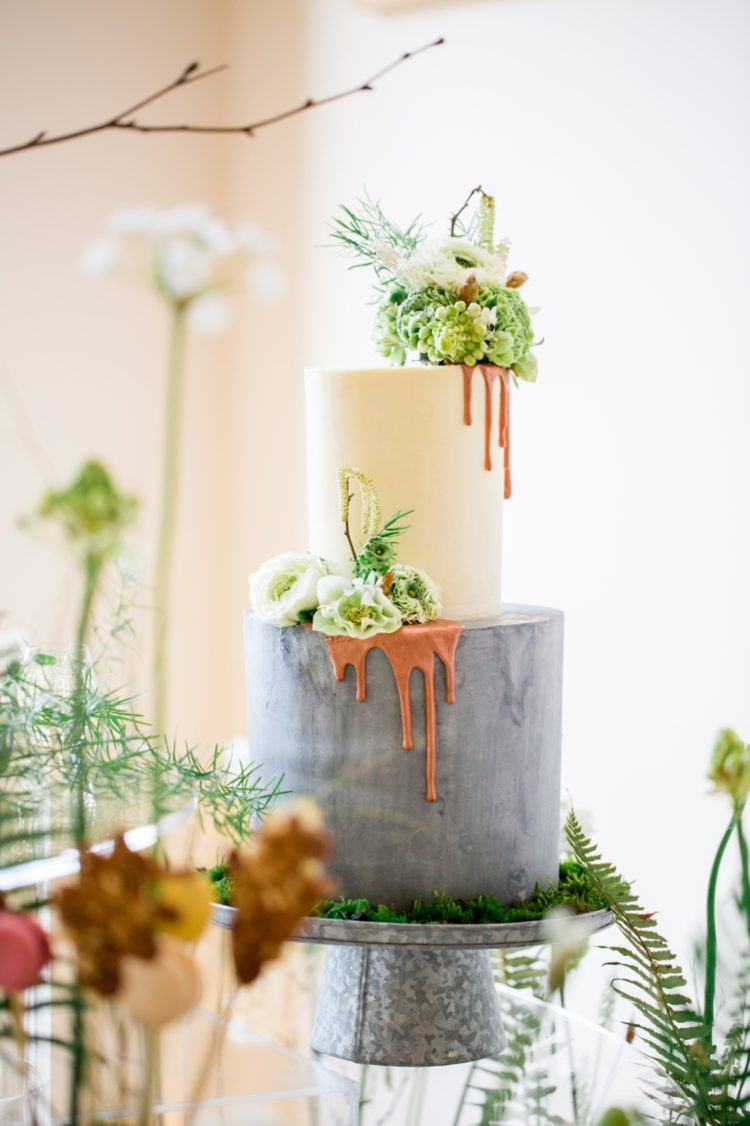 The wedding cake was a concrete-inspired one, with matte layers, drip icing and fresh blooms