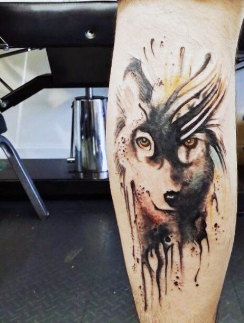 Beautiful wolf tattoo on the leg