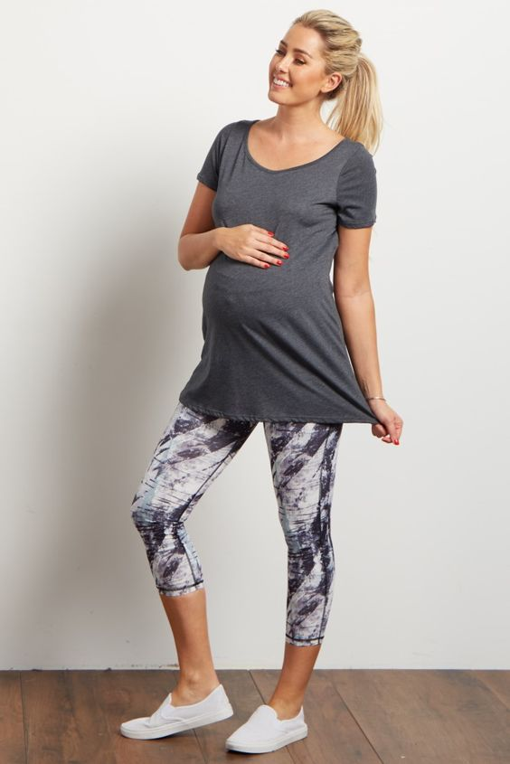 printed cropped leggings, a grey tee and white sneakers