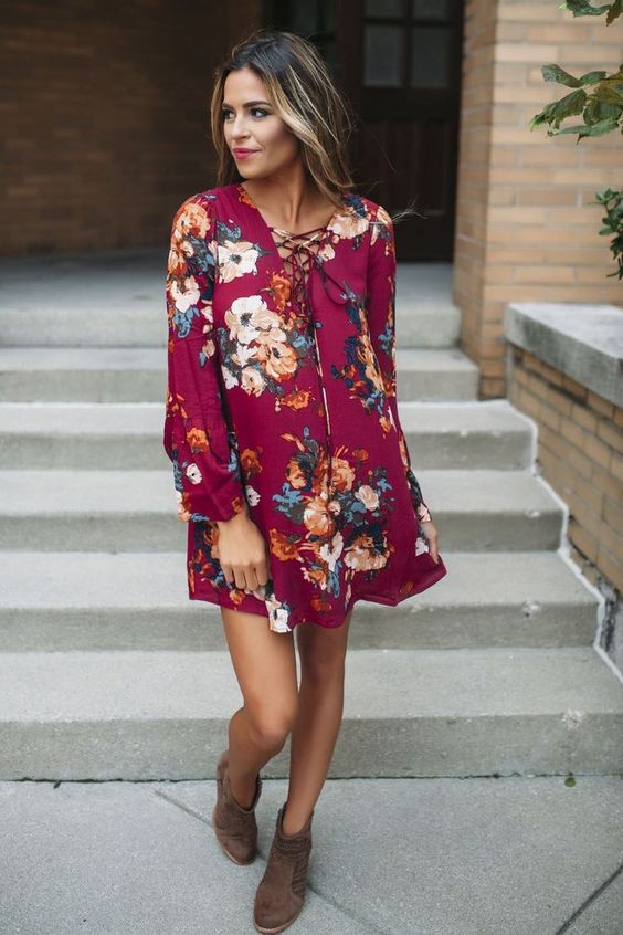 fuchsia mini dress with lacing up, long sleeves and floral prints worn with brown ankle booties