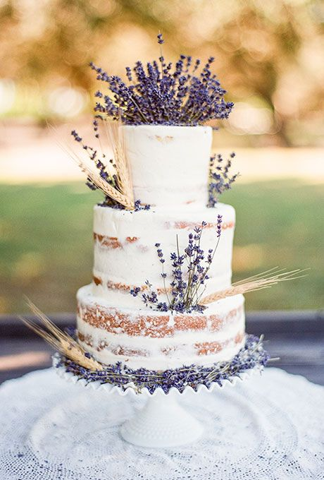 semi naked wedding cake decorated with lavender and wheat looks delicious